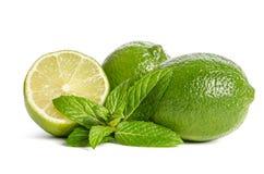 Grön mintkaramell och limefrukter Royaltyfri Bild