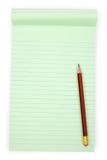 grön notepaper arkivbild
