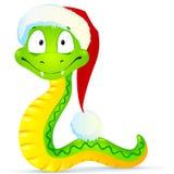Grön orm i blåa Santas hatt Arkivfoton