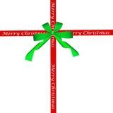 Grön pilbåge och rött julband Arkivfoto