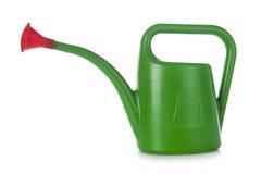 Grön plast- som bevattnar kan på vit Fotografering för Bildbyråer