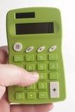 Grön räknemaskin Arkivbild