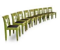 grön rad för stolar Arkivbild