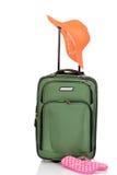 Grön resväska med hatten och sandaler Royaltyfria Foton