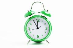 Grön retro klocka Arkivbild