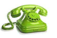 Grön retro telefon på vit bakgrund Royaltyfri Bild