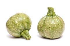 grön round två för zucchinier Arkivbilder