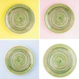 Grön rund keramisk platta med den spiral modellen arkivbild