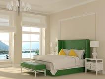 Grön säng i den vita inre Arkivbilder