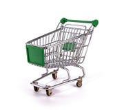 grön shoppingtrolley Fotografering för Bildbyråer