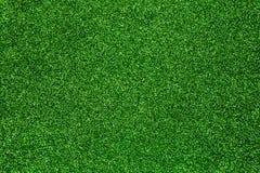 Grön skinande bakgrundsgräsplanbakgrund med mousserar Royaltyfri Bild