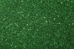 Grön skinande bakgrundsgräsplanbakgrund med mousserar Royaltyfria Bilder