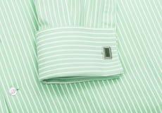 Grön skjortakrage och manschettknappar Arkivfoton