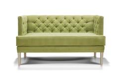 Grön sofa som isoleras på vit bakgrund royaltyfri bild
