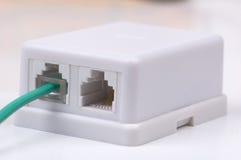 grön stickkontakt för kabel arkivfoton