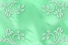 Grön suddig bakgrund med blommor i hörn Arkivbild