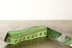 Grön tapemeasure Royaltyfria Bilder