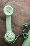 Grön tappningtelefon Arkivbild