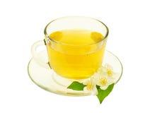 Grön tea med jasminblommor som isoleras på vit Royaltyfria Foton