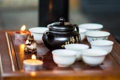 Grön tea med koppen och teapoten Royaltyfri Foto