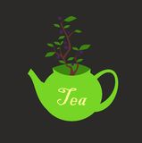 Grön tekanna med inskriften på sidan och ett blåbär Bush som växer ut ur det Symbolet av det gröna teet med blåbär Il Arkivbild