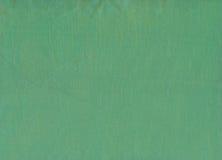 Grön textur för siden- tyg Arkivbilder