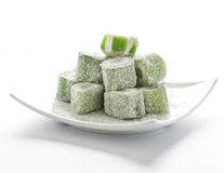 Grön turkisk fröjd med kokosnötflingor Royaltyfria Foton