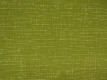 Grön tygbakgrund Arkivfoto