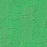 Grön väggmålarfärg med en sömlös och tileable texturphot för fläck Royaltyfri Foto