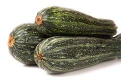 Grön zucchini som tre isoleras på vit bakgrund Arkivbilder