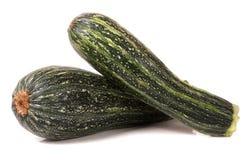 Grön zucchini som två isoleras på vit bakgrund Arkivfoton
