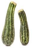 Grön zucchini som två isoleras på vit bakgrund Royaltyfria Bilder