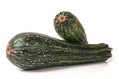 Grön zucchini som två isoleras på vit bakgrund Arkivfoto