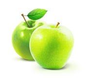 Gröna äpplen och leafe som isoleras med den snabba banan Fotografering för Bildbyråer