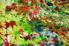 Gröna blåa orange silvriga vattenfärgfärgstänk, abstrakt idérik bakgrund för målarfärg Fotografering för Bildbyråer