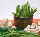 gröna champinjoner för bönor Arkivfoto