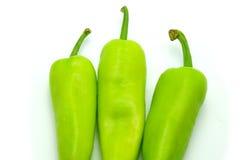Gröna Chili Peppers på vit bakgrund Fotografering för Bildbyråer