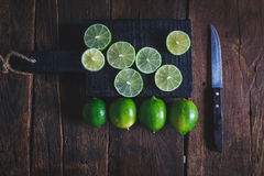 gröna citroner Fotografering för Bildbyråer