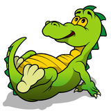 Gröna Dino Laying Arkivfoton