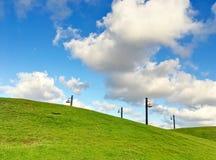 Gröna gräs- kullar fotografering för bildbyråer