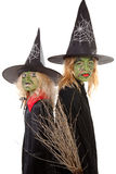 gröna halloween två häxor Arkivbild