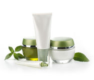 Gröna kosmetiska flaskor Royaltyfri Bild