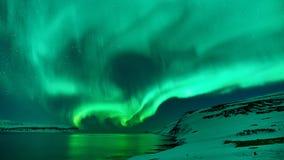 Gröna nordliga ljus i Island arkivfoto