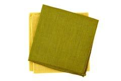 Gröna och gula textilservetter på vit Fotografering för Bildbyråer