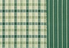 Gröna och vita textilprövkopior. Arkivbild