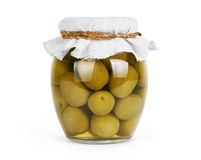 Gröna oliv som bevaras i banken, flaska Royaltyfri Bild