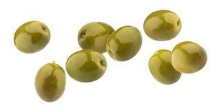 Gröna oliv som isoleras på vit bakgrund med den snabba banan arkivbilder