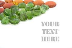 gröna orange stenar Arkivfoto