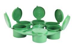 Gröna plast- gemensamma askar ställde in med den snabba banan Royaltyfria Bilder