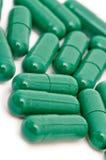 Gröna preventivpillerar Arkivbilder